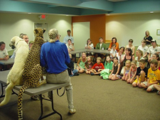 Zoo officials share Alexa and Sahara's unique story with students at a local school.