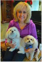 Little Bella (front) was able to alert her owner to her undiagnosed cancer.