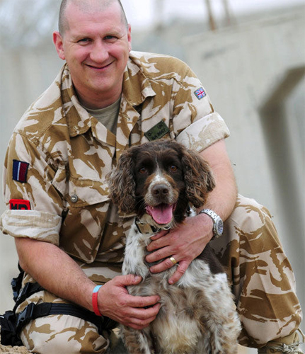 Buster and his owner/handler RAF Police Sergeant Michael Barrow are now enjoying a quieter life. (Photo by Corporal Scott Robertson)