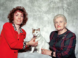 Chelsea and her owner (r) with Dr. Marguerite Hoey (l).