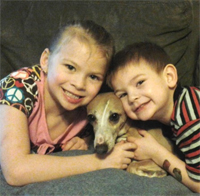 Lilian Dausman, 6, and her dog Dauz on his first night home after being lost for eight months.