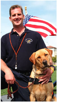 Tim Brun of the LAFD and his canine partner Duncan.