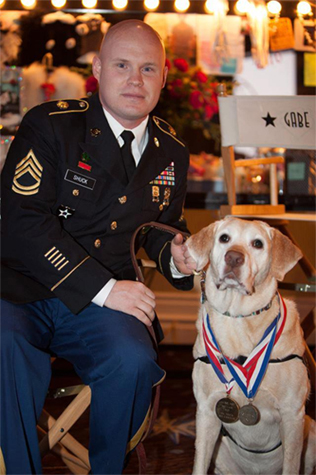 Army Staff Sergeant Charles Shuck and his hero MWD Gabe at the Hero Dog Awards.