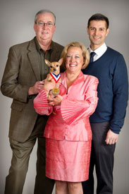 Kanga with her owners John and Mary Rudder and her Vet, Dr. Joseph Martins