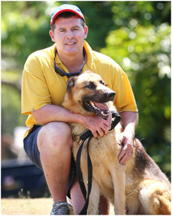 Rocky with handler and dog squad officer Neil Smith.