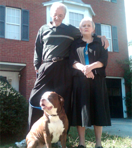 John and Gloria Benton with their hero dog Titan.
