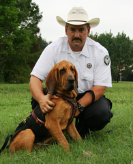 Ranger Kevin Pierce with Annie, the first arson dog to work for the Texas Forst Service.