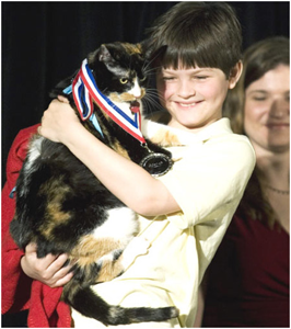 A proud Alex holds Mel-O after she is inducted into the Purina Hall of Fame.